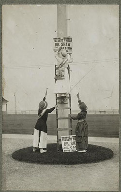 """Women posting a sign that reads """"Votes for Women: Dr. Shaw"""""""