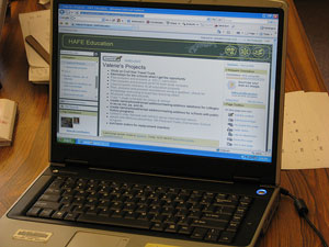 A laptop computer showing a screen of work-in-progress tasks