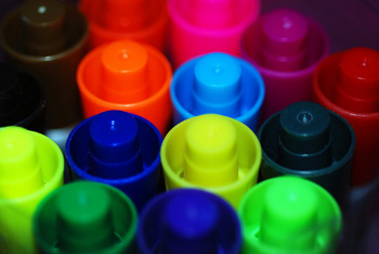close photo of the tops of 14 markers in different colors