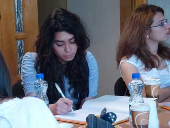 A photograph young woman taking notes during a training session