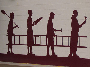 A mural showing the outlines of four people carrying a ladder and working together on a project.