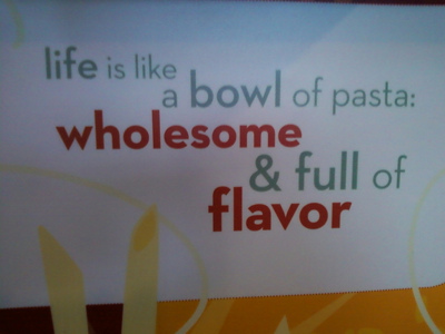"""A sign that says """"life is like a bowl of past: wholesome & full of flavor"""""""