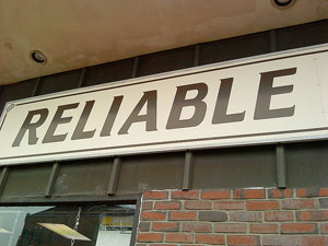 """A sign outside of a store that reads: """"Reliable"""""""