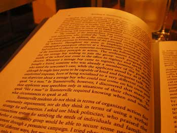 Image of open book with several paragraphs of text