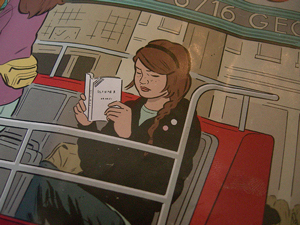 A comic/graphic drawing of a girl sitting on a bus seat reading a book.