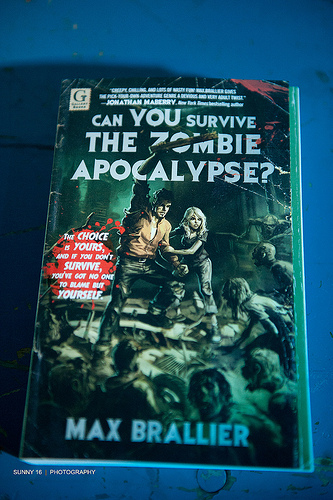 """A photograph of the cover of a book titled """"Can You Survive the Zombie Apocalypse?"""""""