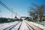 A photograph of railroad tracks in the snow