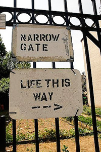 """A sign that reads """"Narrow gate: Life This Way"""" with a right pointing arrow"""