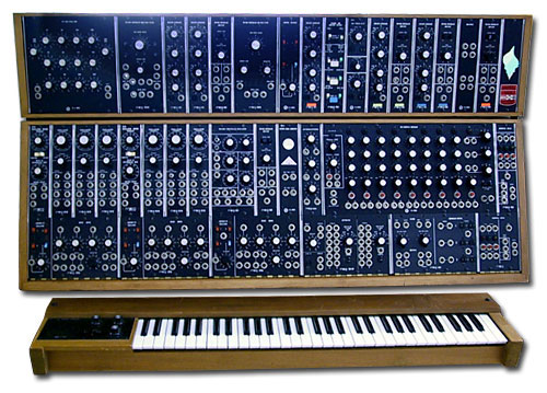 A photograph of a MOOG synthesizer. It is a key board and a mixing board.